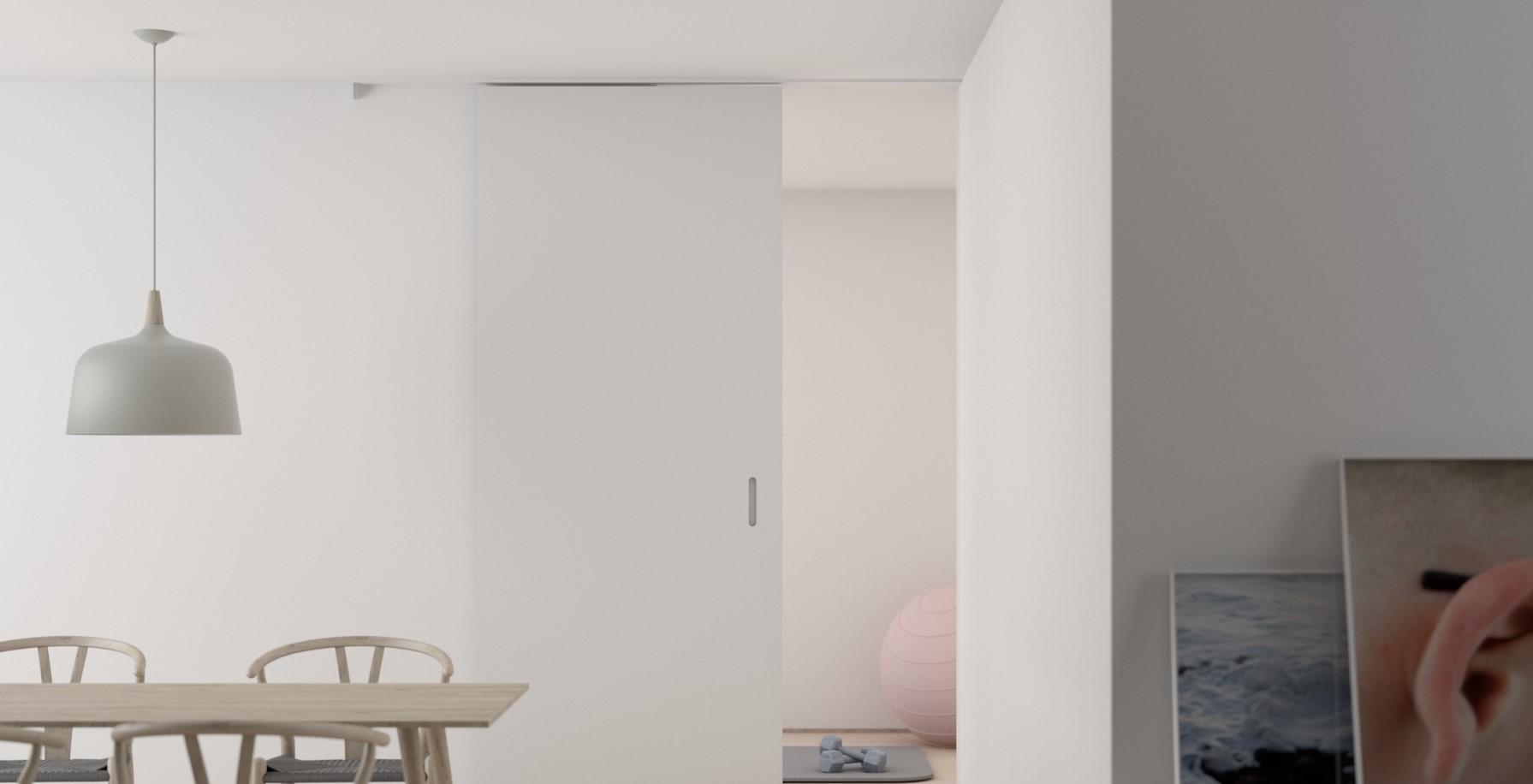 Salle à manger blanche avec luminaire suspendu