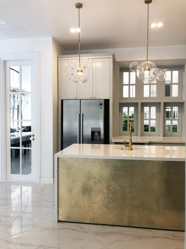 White kitchen with pendant lights and an island