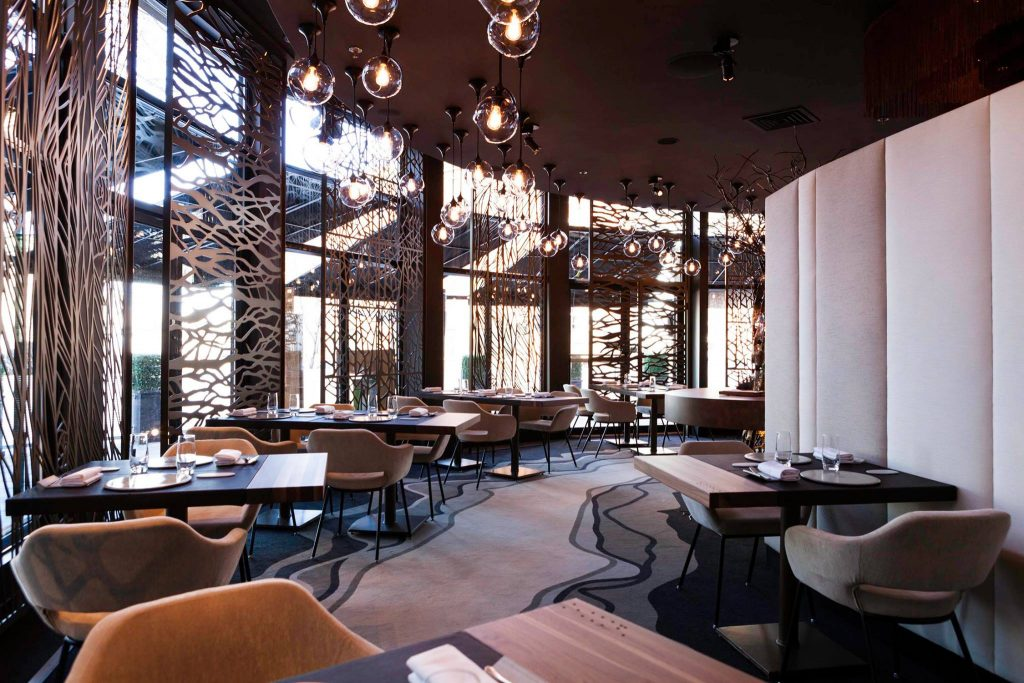 Brown restaurant dining room with industrial style