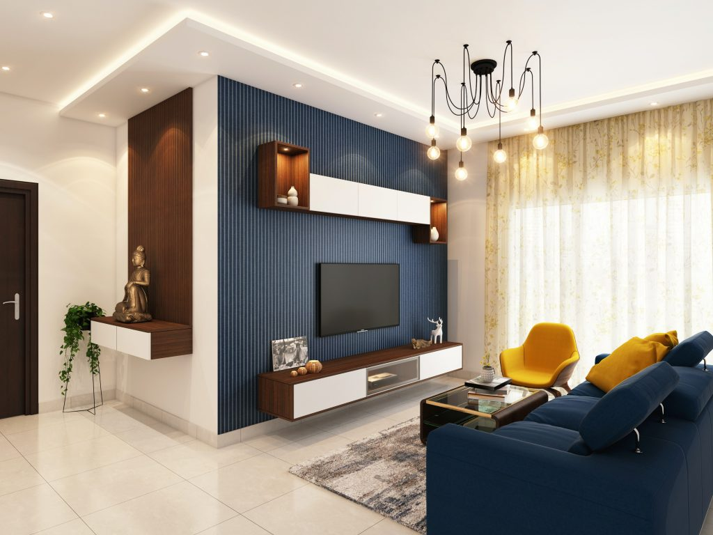Salon bleu et blanc avec un luminaire suspendu