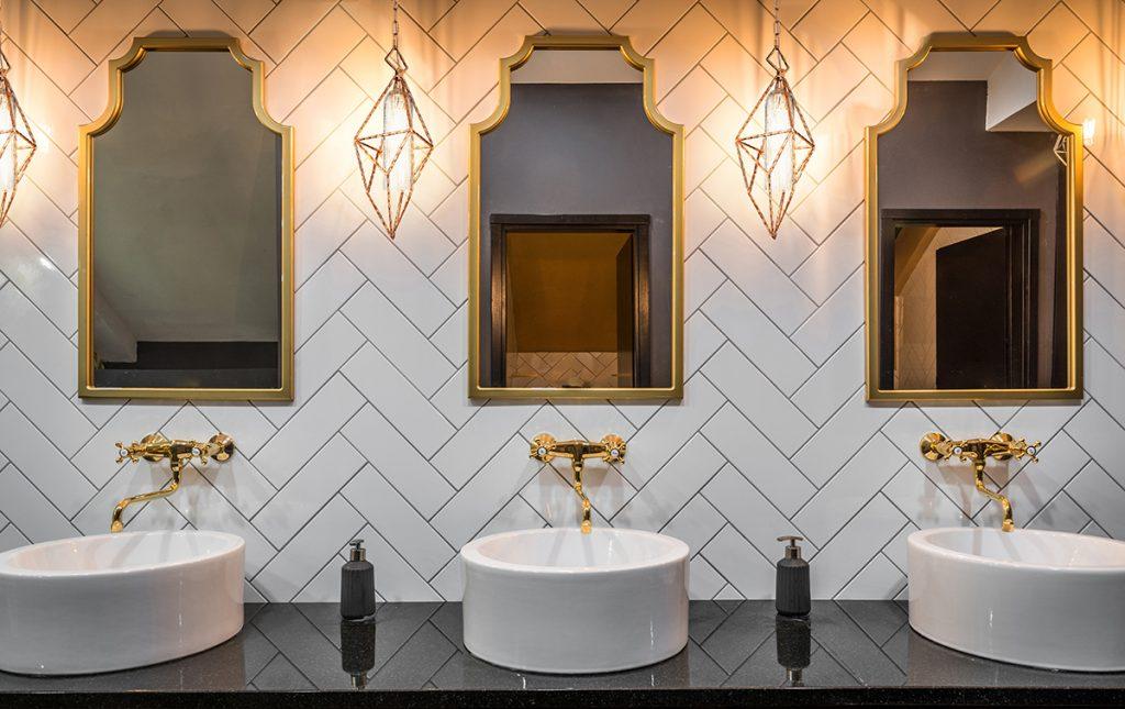 Public bathroom with pendant light fixtures