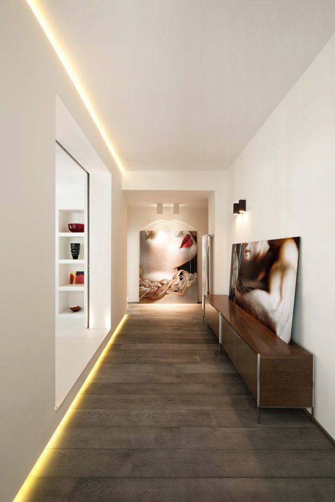 Hallway with indirect LED lighting on ceiling and floor