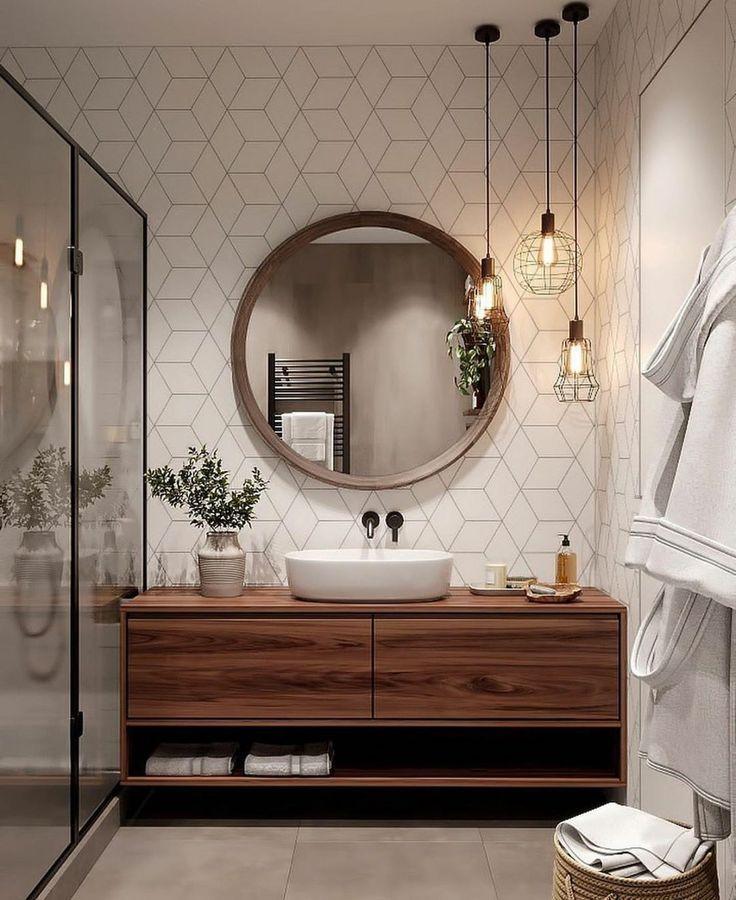 White bathroom with circular mirror
