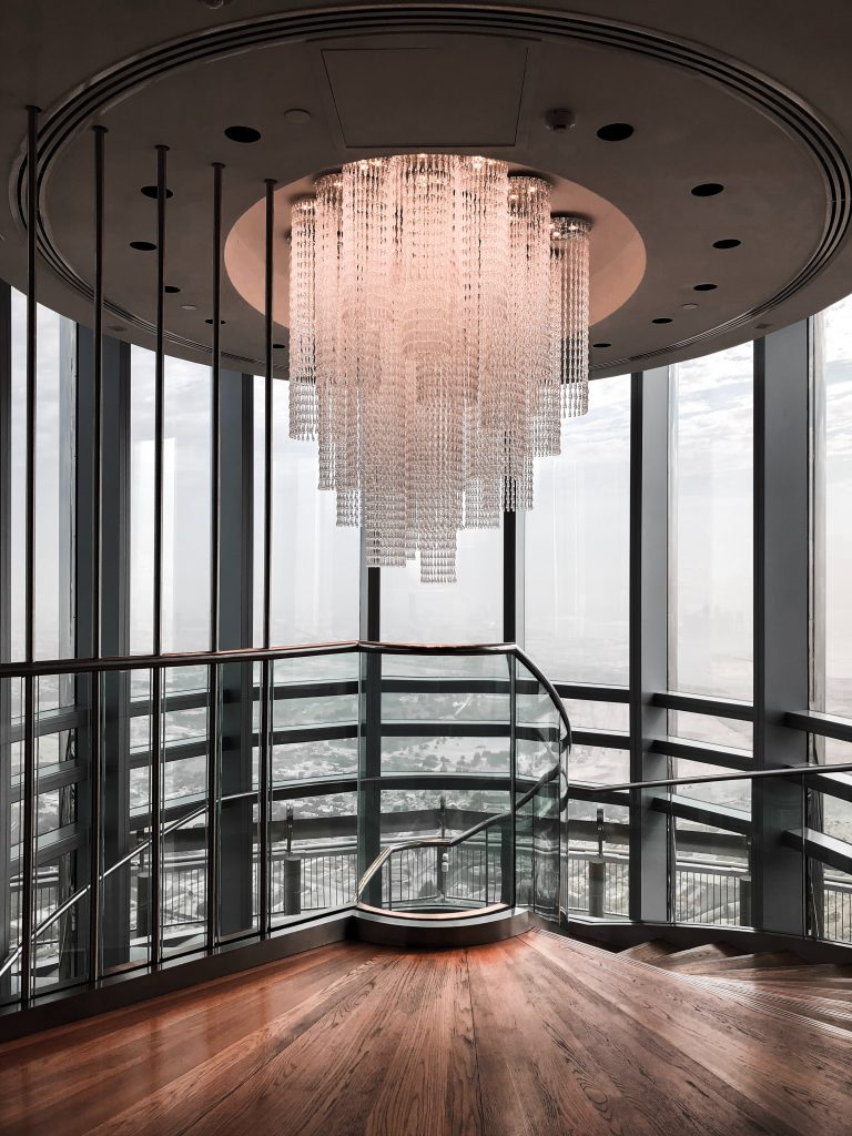 Huge ceiling light overhanging a circular staircase