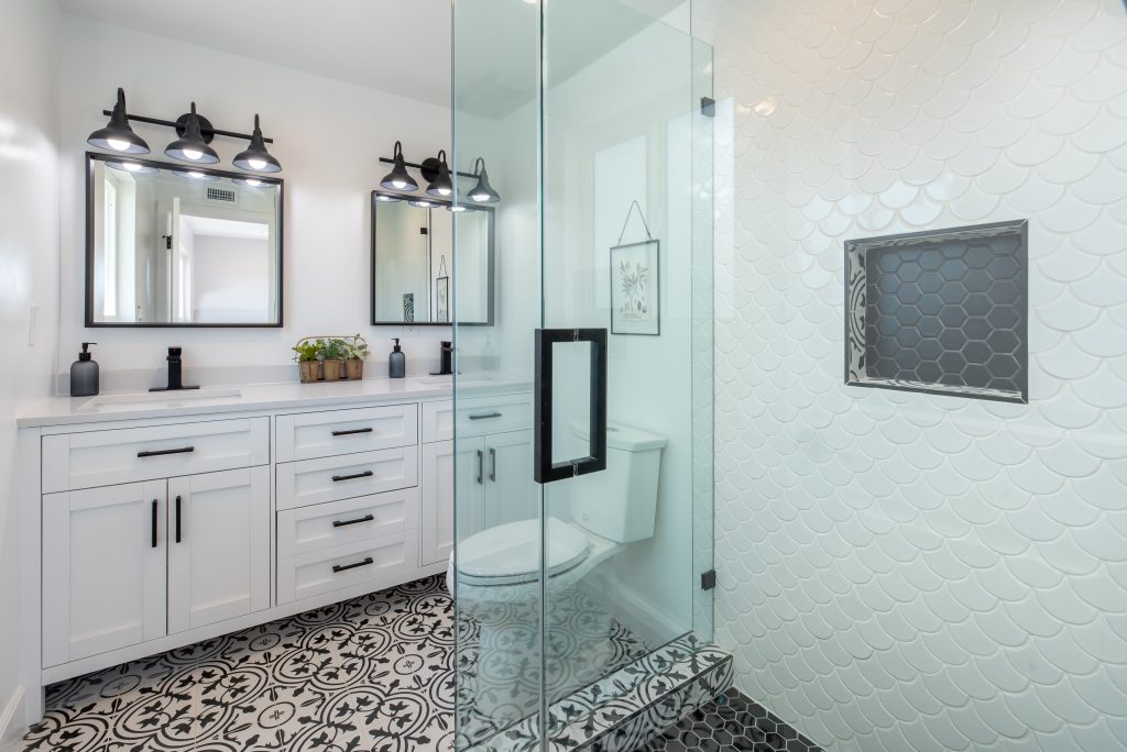 white bathroom with a glass door