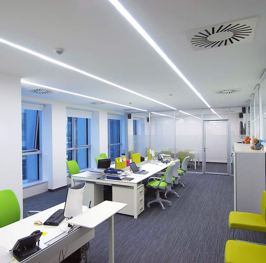 Open collaborative office with colorful chairs