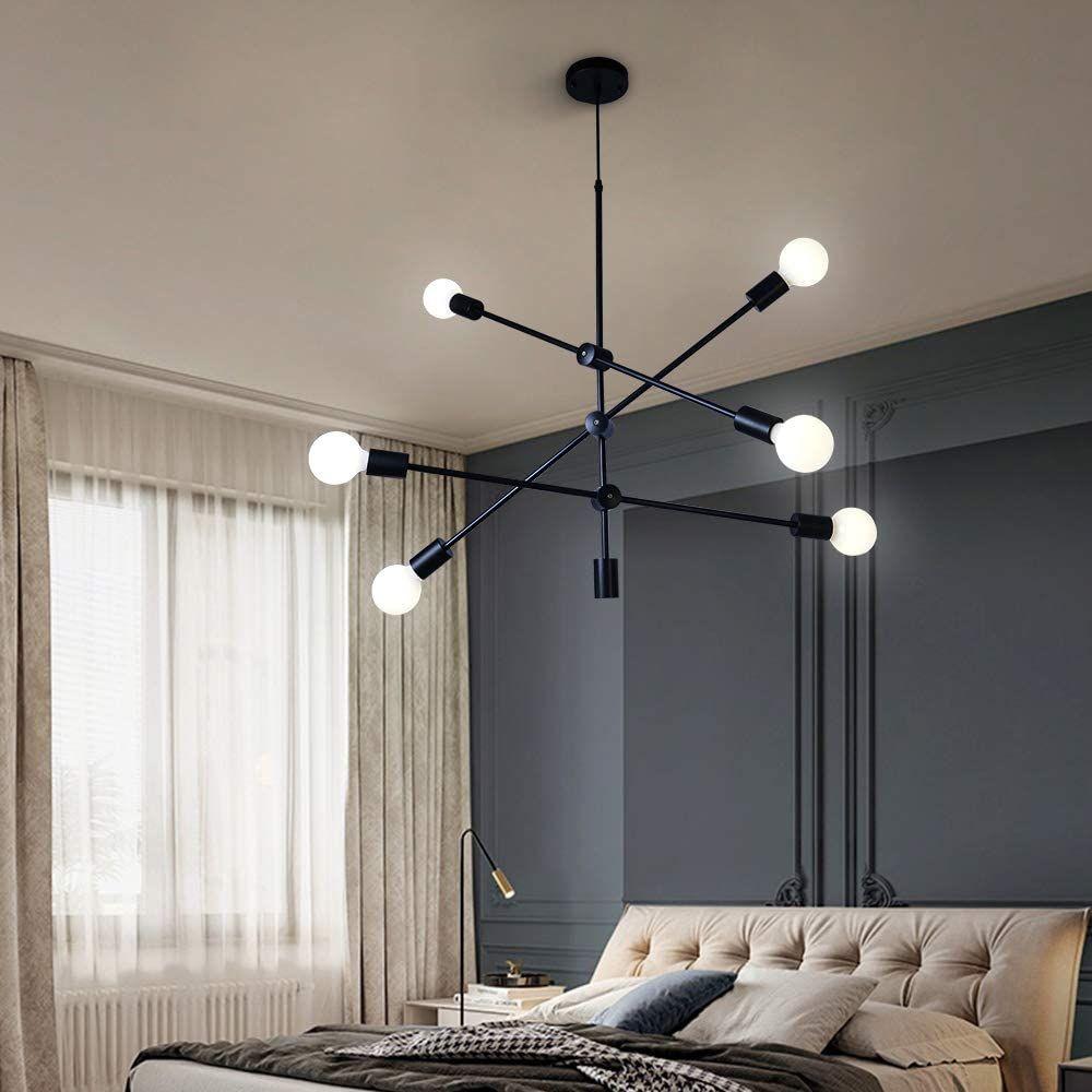 Chambre à coucher illuminée par un luminaire suspendu